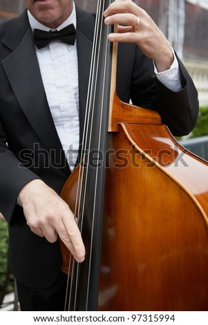 Jazz musician playing upright bass at luxury party