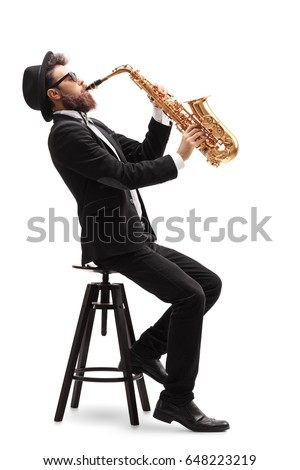 Jazz musician seated on a chair playing a saxophone isolated on white background