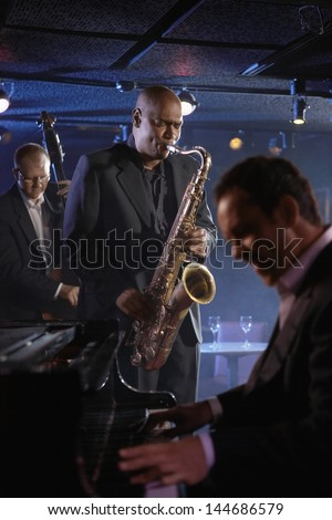 Jazz musicians performing in the club - stock photo