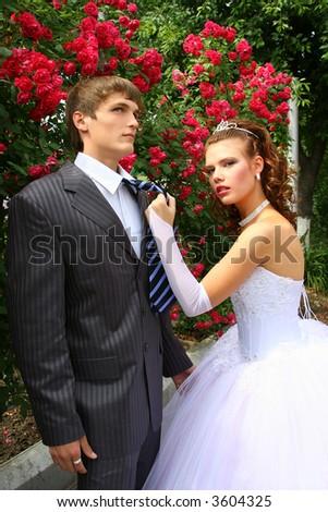 jealous bride with groom - stock photo