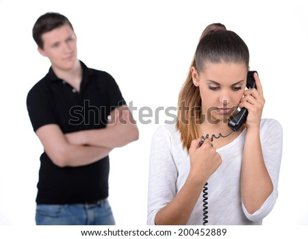 Jealous man behind the women who talk on the phone - stock photo