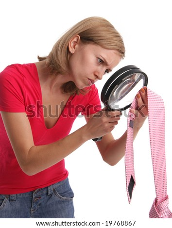 Jealous wife in search proofs attentively considers a tie of the husband 5 - stock photo