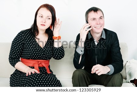 Jealous woman eavesdrop - stock photo