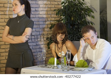 jealousy scene between couple in a restaurant - stock photo