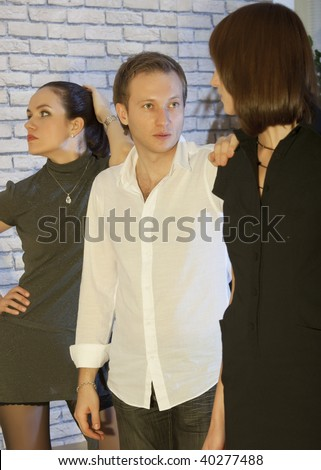 jealousy scene - man with girlfriend talking to his lover - stock photo