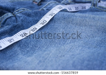jean and scales tape background - stock photo