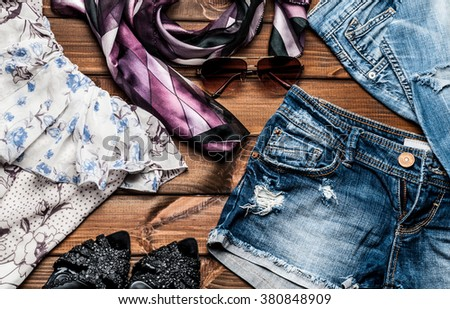jeans and fashion accessories on wooden boards - stock photo