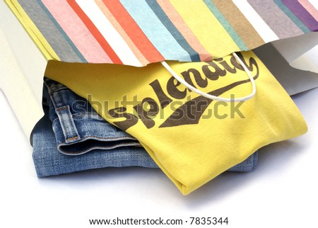 Jeans and t-shirt, just bought and still in paper bag. - stock photo