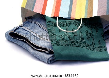 Jeans and t-shirt still in striped paper bag.