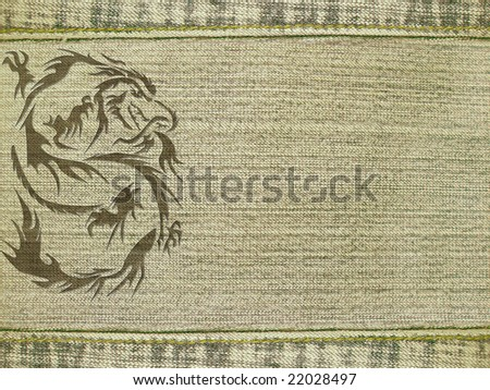 Jeans background of beige color, with dragon