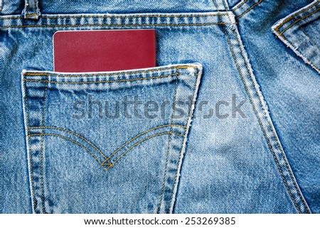 jeans bag with passport - stock photo