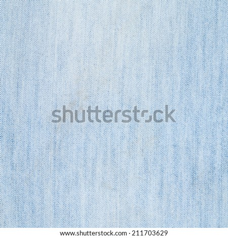 Jeans denim dirty light blue cloth fragment as a background texture composition - stock photo