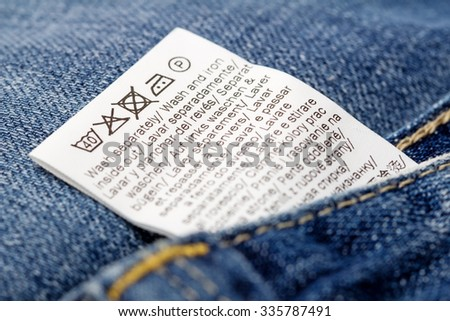 Jeans laundry care label, selective focus - stock photo