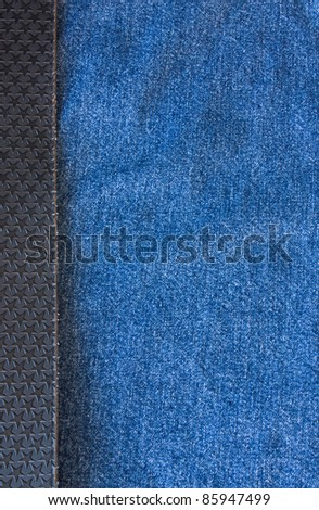 Jeans, on the left side of the frame black belt with texture - stars. - stock photo