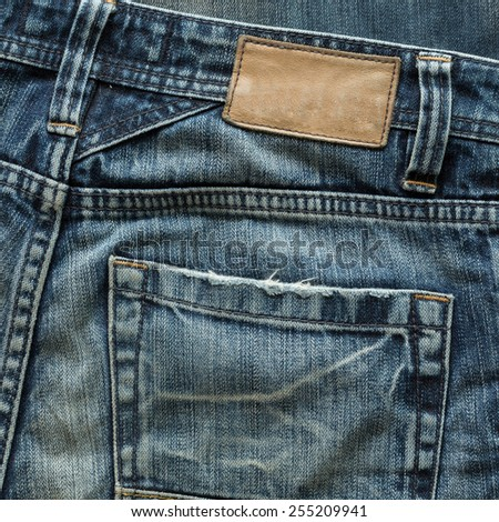 jeans pants with back pocket and brown leather tag - stock photo