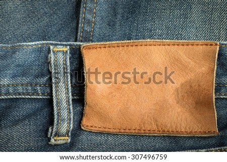 jeans pants with brown leather tag has space for your text - stock photo