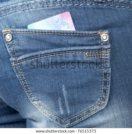 jeans pocket with a discount card - stock photo