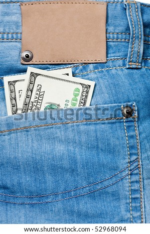 Jeans pocket with one hundred dollars banknotes - stock photo
