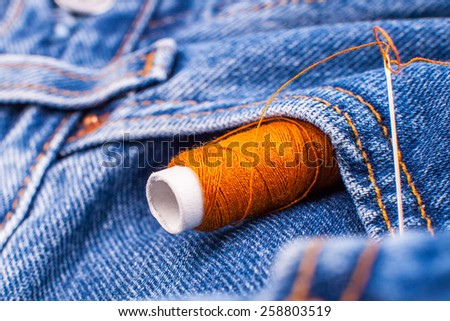 jeans sewing - stock photo
