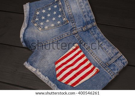 Jeans shorts in wood background