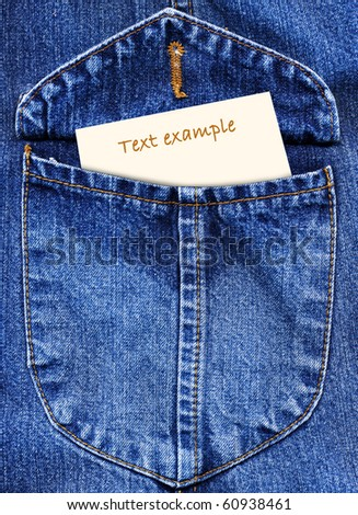 Jeans textile pocket with a paper note without the text, looking from it