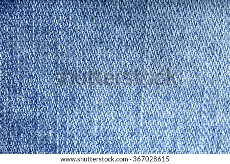 Jeans texture background - worn jean pants fabric of blue washed denim textile. Closeup of fashion cotton weave for background or copy space. - stock photo