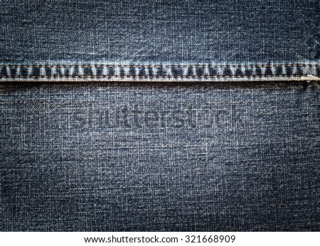 Jeans texture with seam, Close up jeans background - stock photo