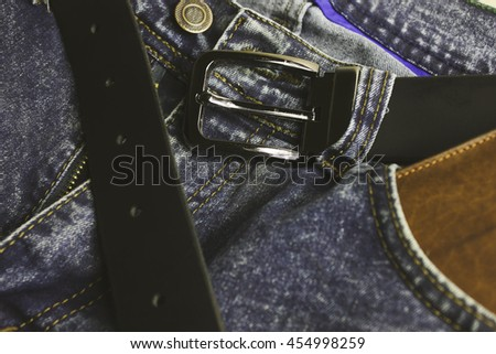 Jeans Wallet and Belt on wood background,top view
