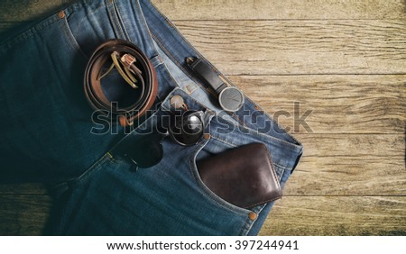 Jeans Wallet and Belt watches glasses  on wood background,top view,vintage color