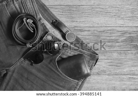 Jeans Wallet and Belt watches glasses  on wood background,top view,W/B Image