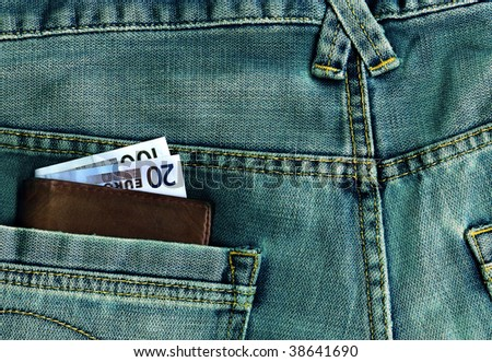 Jeans with money - stock photo
