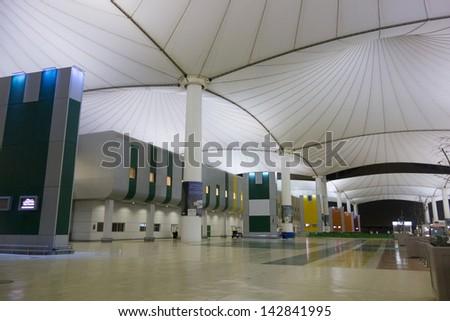 JEDDAH,SAUDI ARABIA-JUNE 9:Pilgrims at Jeddah Hajj International Airport in Jeddah on June 9, 2013. The airport which cater for hajj pilgrims during hajj season is the busiest airport of Saudi Arabia. - stock photo