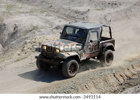 Jeep in offroad action - stock photo