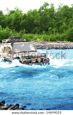 Jeep in river - stock photo