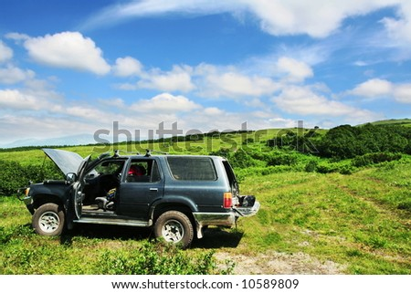 Jeep on grassland - stock photo