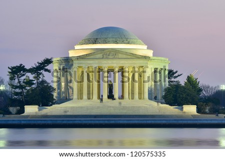 Jefferson Memorial silhouette at sunset with mirror reflection on water, Washington DC United States - stock photo