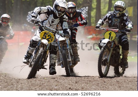 JEFFERSON, TEXAS - APRIL 5:  Dirt and dust surround start of race as riders relive past glories in AHRMA Vintage Motocross National Championship Series race in Jefferson, TX on April 5, 2009. - stock photo