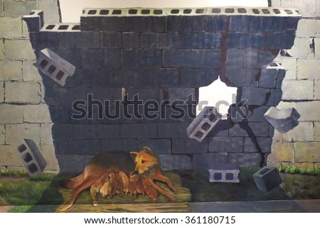 JEJU, SOUTH KOREA - NOV 29, 2015 : Photo of 3D Wall Painting of Street Dog breast feeding her little puppies under the shade of the falling concrete wall. - stock photo