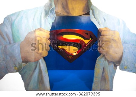 JEJU, SOUTH KOREA - NOV 29, 2015 : Photo of 3D Wall Painting of Superman, from a famous scene where Clark Kent is transforming into Superman by wearing on top of his shirt and reveal his Superman suit - stock photo