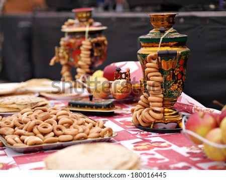 JEKABPILS, LATVIA - MARCH 1: Russian samovar on table at Celebration of Maslenitsa - traditional Russian holiday - on March 1, 2014 in Vecpilsetas Laukums, Jekabpils, Latvia - stock photo