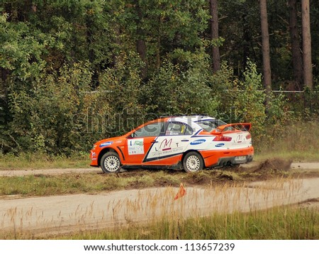 Jekabpils, LATVIA-SEPTEMBER 22: Andis Neiksans and Peteris Dzirkals drives Mitsubishi Lancer Evo during a motoring event Rally sprint Viduslatvija 2012 in Jekabpils, Latvia on September, 2012.