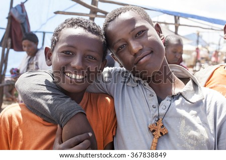 JELDU GOJO, ETHIOPIA-NOVEMBER 5, 2014: Unidentified Christian boys in the region of Jeldu Gojo, Ethiopia. - stock photo