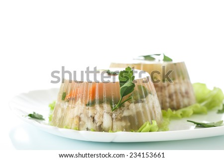 Jellied fish with egg and vegetables on a white background - stock photo