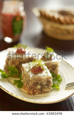 Jellied with horseradish sauce and greens - stock photo