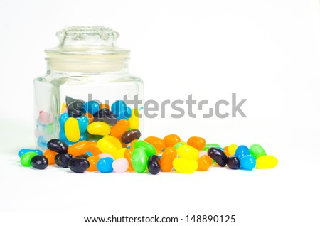 Jelly beans sugar candy snack in a jar isolated on white  - stock photo