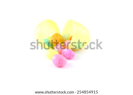 Jelly beans with easter egg isolated over a white background. - stock photo