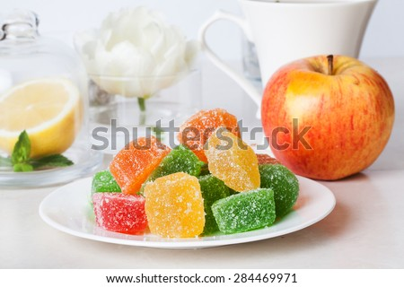 jelly candies on a plate in a still life tea party dessert treat poison - stock photo