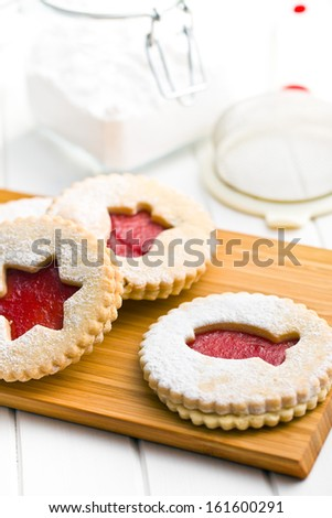jelly christmas cookies on wooden kitchen board