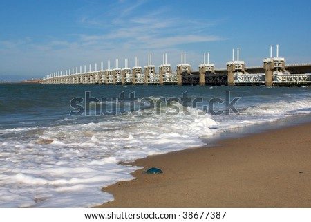 Jellyfish in front of delta-bridge - stock photo