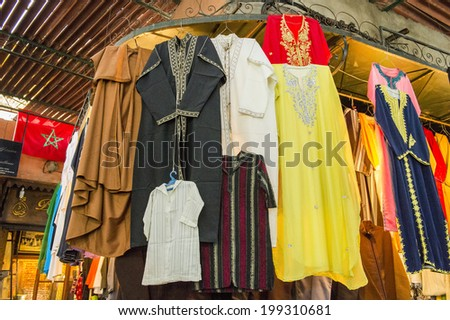 JEMMA DAR FNA, THE MAIN BAZAAR, MARRAKECH, MOROCCO, MAY 11, 2014. Clothes for sale in a shop in Jemma Dar Fna, Marrakech, Morocco, on May 11th, 2014.  - stock photo